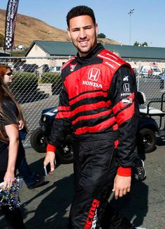 Klay Thompson of the Golden State Warriors NBA team walks to the track for a ride in a twoseat IndyCar with driver Davey Hamilton on day 3 of the. Nba Players, Basketball Players, Clay Thompson, Thompson Warriors, Golden State Basketball, 2018 Nba Champions, Curry Warriors, Sports Illustrated Covers, Golden State Warriors Pictures