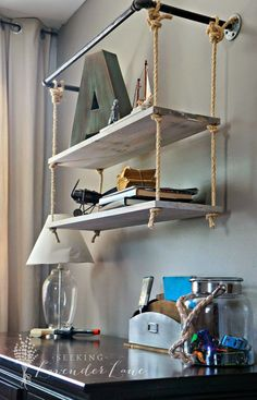 Flexible Ways To Decorate With Hanging Shelves. A mix of pipes and ropes for hanging shelves, I really like these! Especially with the patina metal letter there