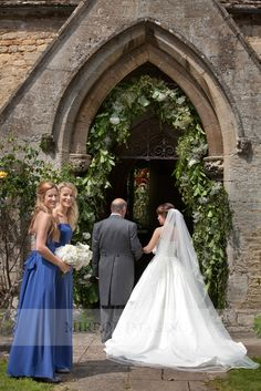 A green floral arch around your church entrance : Mirror Imaging Photography: Laura & Nick's Stamford & Lincs Wedding