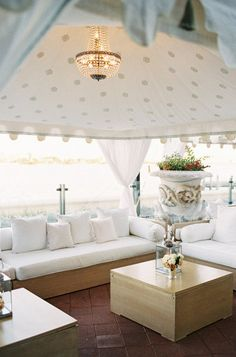 Modern meets vintage chic in this beautiful tented wedding lounge. #wedding #furniture #decor