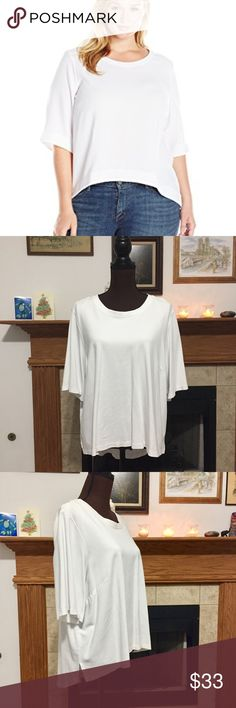 """Melissa McCarthy Survival Basics White top PLUS Super clean! Great basic top with a high low design - longer in the back than the front. Great coverage! Simple staple!  Measurements and Details: Length (Back): 27.75"""" Length (Front): 21.5"""" Chest: 24.5"""" Sleeve Length: 12.75"""" Shoulder - shoulder: 18"""" Material: 68% Rayon, 27% Nylon, 5% Spandex Size: 2X Pre-owned, washed, worn. No rips or stains. Melissa McCarthy Seven7 Tops Tees - Long Sleeve"""