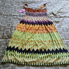 Beautiful  summer dress Amazing print. With greens and purples,  nice tribal design,  perfect dor summer,  brand new still with taggs size small does have some stretch on the bust Dresses