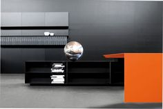 Love the pop of orange in this sleek office - modern contemporary