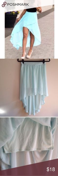 Charlotte Russe light blue high-low skirt Charlotte Russe light blue high-low skirt. Has a light blue slip with a sheer layer overtop. Flows out behind you as you walk, very pretty for the spring, summer or as a beach cover up. Size small. Not the exact same as the stock photo, but very similar. Has a pen mark but that is in the folds and not noticeable when work. Bundle to save!  #assymetric skirt, hi-lo skirt, high low skirt, chiffon skirt, blue skirt, flowy skirt, summer wear, Charlotte…