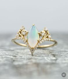 b54683732 For this opal engagement ring, we were going for delicate, regal, classic.