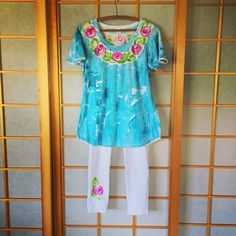 Lovely light Cotton tunic top in aqua with roses.  Hand Painted from Kaua'i Hawaii - available in size s - 2x.  Separate listing for leggings in my shop.  Machine wash and dry.