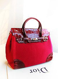 plum red soft felt feel base with maroon red leather crocodile effect on corners and flap of the tote handbag.