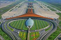 Beijing Capital International Airport Terminal 3 - Foster + Partners - The second largest passenger terminal in the world. Norman Foster, Airport Architecture, Amazing Architecture, Landscape Architecture, Contemporary Architecture, Shenzhen Airlines, Airport Terminal 3, Beijing China, Futuristic Architecture