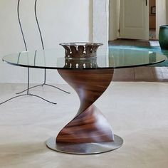 The Elika table @porada0366 - a striking spiral base available in a range of wood finishes with glass top & satin chromed metal disc base.