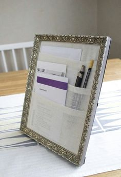 I made one of these a long time ago and put it next to my front door for school notes, signed school forms, mail etc.  Way handy!