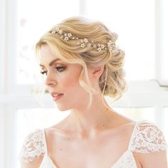 The Eden wedding headpiece hair vine is a stunning hair accessory which combines intricate beautiful Swarovski crystal and pearl beads which are hand-wired together to create small delicate flowers. An wonderfully beautiful bridal headpiece. Bohemian inspired wedding headpiece designed & handmade in the UK by British bridal designer Rachel Chaprunne. Entwined flowers and delicate sparkle to accessorise an array of beautiful wedding day styles.