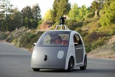 Google, Detroit diverge on road map for self-driving cars
