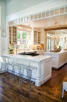 Shawna'sKitchen Kitchen- Loving the ghost bar stools and detailed molding all around.