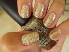 <3 this...OPI's Spark De Triomphe - fine gold glitter with chunky silver glitter in a clear base3 coats shown