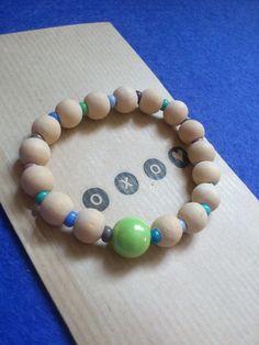Bracelet eélastique perle en bois naturel et petite perles rocailles