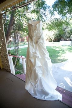 Bridal Dress (back View) hanging out side the Twin Oaks School House.