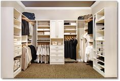 Walk in closet by Marco Closets