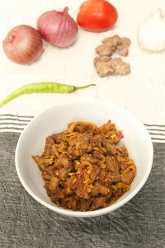 Beef Chili Fry = Tender, Juicy perfectly stir fried Beef undercut and some tickling green chili to enhance the onion and tomato flavor. Perfect!