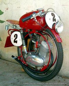 The 1954 MV Augusta 60cc Monomoto Superleggera. This MV Augusta is the experimental machine ridden by young wealthy Italian Luiggi Bandini, during practice for the 1954 Milano-Taranto Road Race. Bandini tragically lost control in a misty mountain section, while waving to a pretty spectator. See: http://www.way2speed.com/2012/05/1954-mv-augusta-60cc-monomoto.html#axzz2ZXXaCTDx