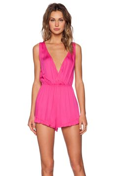 MINKPINK Sweet Dhalia Playsuit in Magenta can double up as a casual day look and beach cover up.