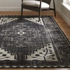 Shop Anice Black Hand Knotted Oriental Rug.  The inherent drama of a classic Persian rug stops the show in streamlined black-and-white interpretation of traditional design motifs.