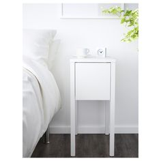 IKEA - NORDLI, Bedside table, white, On the hidden shelf is room for an extension socket for your chargers. The cable to the socket can be hidden in the groove along the table leg. Bedside Table Ikea, Small Nightstand, Bedside Table Design, Small White Bedside Table, Nightstand Ideas, Ikea Bedroom, Bedroom Storage, Bedroom Apartment, Bedroom Organization