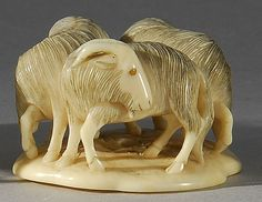 Lot 197: IVORY NETSUKE In the form of three rams standing on a circular platform. Inlaid eyes. Signed. - Eldred's | Invaluable