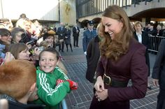 Terry Campbell had reason to smile after being favoured with a hug from Kate when she visited Newcastle 11 Oct 2012