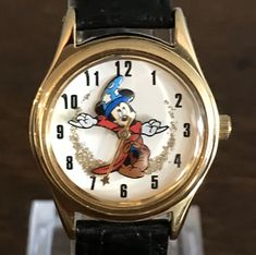 Disney Parks Exclusive Sorcerer's Apprentice Watch- Vintage Women's Mickey Mouse Fantasia Wristwatch by MagicalNostalgia on Etsy Mickey Mouse Dress, Mickey Mouse Watch, Vintage Mickey Mouse, Vintage Disney, Modern Family Quotes, Cruella Deville, The Mindy Project, American Dad, Disney Jewelry