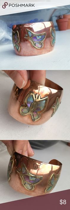 Vintage Cooper Three Butterfly Cuff Copper/brass bracelet with 3  butterflies. 🦋Handmade in Mex. Adjustable. Refurbished VINTAGE bracelet! Found in chest full of jewelry my grandmother used to sell.  Disclaimer:  High quality product but exact material may be incorrect (as I found these). TARNISH varies with each piece. (You may not receive the exact bracelet condition as shown) Cleaned to best condition but will not be perfect. That being said, I will not send a piece I believe is…