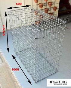 How about a Gabion Cage filled with mud and fine straw materials, stacked in place to form a wall...?