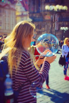 Chasing Bubbles In Old Town Square Prague by Leopard Print Photography Prague (3)