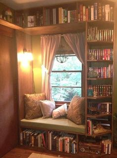 Cozy window seat surrounded by shelves. Love the details…