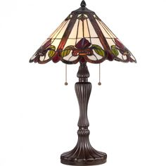 "Quoizel TF1425TWT Tiffany Fields with Western Bronze Finish Table Lamp. Product Design Style: Traditional. Product Finish: Western Bronze. Product Electrical: 2-75W A19 Medium Base (18W CFL). Product Shade: Tiffany Glass - 16"" x 8"" Tifffany Glass Shade Contains 330 Pieces of Tiffany Glass. Product Warranty: Lifetime Warranty on all Electrical Parts."