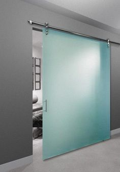 Frameless room divider with designer handle and no bottom track. Made by The Sliding Door Company. - March 23 2019 at Door Dividers, Sliding Room Dividers, Sliding Closet Doors, Hanging Barn Doors, Glass Barn Doors, Sliding Glass Door, Door Design Interior, Interior Barn Doors, Sliding Door Company