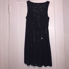 Sequence Black dress Cute little black sparkly dress to wear for a night out. Worn a few times. Perfect condition. Knee length. Forever 21 Dresses Midi