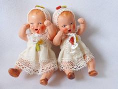 Pair of 3 inch bisque Hertwig and Co miniature antique dolls with pacifiers.