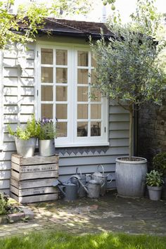 Twig Hutchinson, exterior of summerhouse, Remodelista - love the lavender with zinc and the use of the crates.
