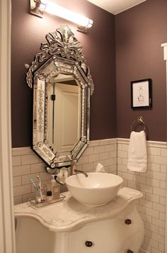 "Where in the world can I find a mirror like that!?!? Also, I love the paint color: ""Love Affair"" by Sherwin Williams."