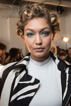 Gigi Hadid looks much older with the wrong hair style and makeup! See beauty photos for Diane von Furstenberg Spring 2016 Ready-to-Wear collection.
