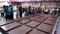 Reporters make images of a huge chocolate bar produced by the Grand Candy factory in the Armenian capital, Yerevan, Saturday, Sept. The chocolate bar that Guinness World Records has certified as the world's biggest, weighs kilograms pounds). Chocolate Day Images, Big Chocolate, Chocolate Factory, Milka Chocolate, Chocolate Company, Chocolate Lovers, Giant Candy Bars, International Chocolate Day, Armenian Recipes