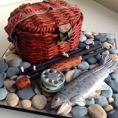 Fishing Basket Cake.  Fishing basket cake with fishing rod & reel, rainbow trout and pebbles.