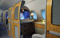 Inside the Airbus A380, the Biggest Passenger Plane in the World    First class passengers will also find a vanity table with drawers, an illuminated mirror, a personal wardrobe, a personal mini‐bar, and a dining table for in‐flight meals.