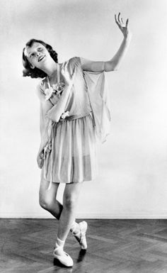 Young Audrey Hepburn in a chiffon dress and ballet shoes.