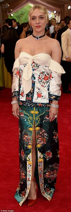 Embracing the theme: Chloe Sevigny's definitely made a fashion statement with her Asian-inspired dress, which featured traditional embroidery that was oddly paired with low hanging sleeves and a front slit