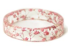 Pink Flower Resin Bangle. Tiny, real flowers set inside clear resin - this is seriously so cool! #jewellery