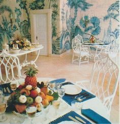 a dining area with great chinoiserie wallpaper