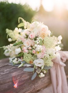 romantic blush and ivory bouquet featuring roses, astilbe, dahlias, snowberries and Queen Anne's lace / http://www.himisspuff.com/astilbes-wedding-ideas/2/