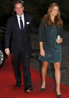 Princess Madeleine in her forest green silk dress and heels and jacket in similar tones brought out her pregnancy glow while Mr O'Neill, who kept a protective hand on her back as they walked, opted for a black suit, navy blue tie and white shirt and pocket square.
