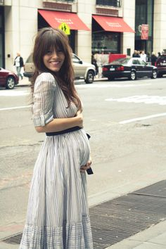 i dont know where to pin this, but i think its adorable! her hair is cute, but that baby bump is even cuter